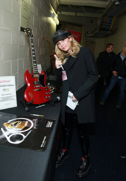 Miley Cyrus Motorcycle Boots [string instrument,musician,guitar,musical instrument,guitarist,musical instrument accessory,electric guitar,plucked string instruments,electronic instrument,miley cyrus,grammy,signings,new york city,madison square garden,charities,grammy charities signings,annual grammy awards]