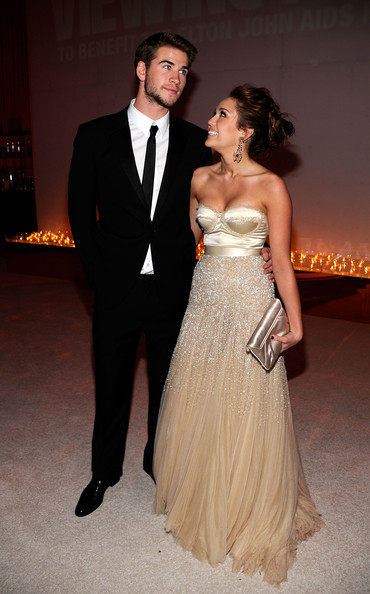 Miley Cyrus Satin Clutch [gown,dress,suit,clothing,formal wear,fashion,wedding dress,tuxedo,bridal clothing,haute couture,miley cyrus,liam hemsworth,exclusive access,rates,pacific design center,west hollywood,california,elton john aids foundation academy award party]