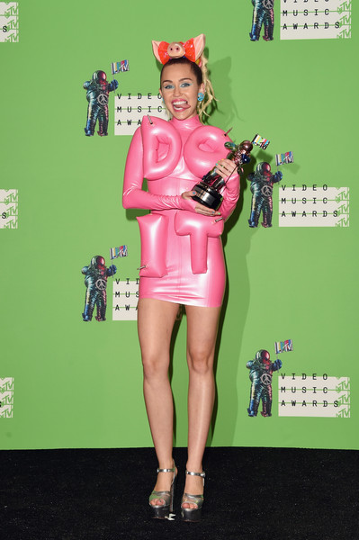 Miley Cyrus Mini Dress [miley cyrus,mtv video music awards,clothing,pink,fashion,leg,footwear,red carpet,flooring,carpet,thigh,dress,room,press room,california,los angeles,microsoft theater]