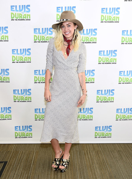 Miley Cyrus Print Dress [the elvis duran z100 morning show,footwear,flooring,fashion,fashion model,carpet,shoe,product,girl,miley cyrus,coverage,new york city,z100 studio,miley cyrus,malibu,whtz,new york city,photograph,actor,singer,celebrity]