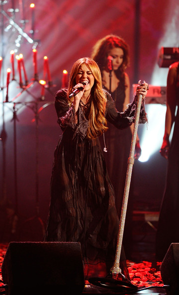 Miley Cyrus Sheer Dress [performance,entertainment,performing arts,musician,music,music artist,red,concert,singing,stage,miley cyrus,american music awards,california,los angeles,nokia theatre l.a. live,show]