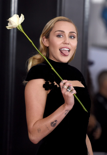 Miley Cyrus Diamond Ring [beauty,smile,lady,shoulder,fashion,blond,photography,plant,flower,model,arrivals,miley cyrus,grammy awards,new york city,madison square garden,annual grammy awards]