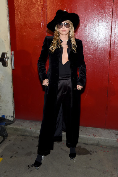 Miley Cyrus Evening Coat [clothing,standing,outerwear,suit,formal wear,coat,hat,style,arrivals,tom ford - arrivals,tom ford,miley cyrus,new york city,new york fashion week]