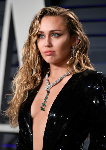 Miley Cyrus Diamond Statement Necklace [oscar party,vanity fair,hair,hairstyle,lady,beauty,blond,fashion model,fashion,long hair,lip,model,beverly hills,california,wallis annenberg center for the performing arts,radhika jones - arrivals,radhika jones,miley cyrus]