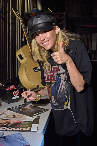 Miley Cyrus Graphic Tee [musicares person of the year,string instrument,musical instrument,musician,music,costume,performance,artist,plucked string instruments,music artist,miley cyrus,autograph,new york city,radio city music hall,grammy awards]