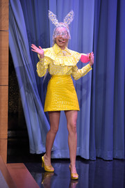 Miley Cyrus completed her retro look with a yellow croc-effect mini skirt, also by Miu Miu.