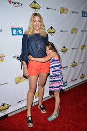 Busy Philipps finished off her outfit with gold and black platform loafers.