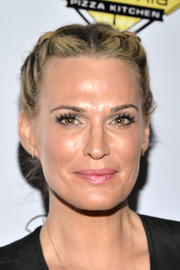 Molly Sims attended the Milk + Bookies Story Time celebration looking boho-glam with her double French braids.