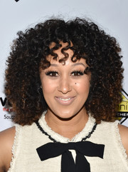 Tamera Mowry sported a shock of curls at the Milk + Bookies Story Time celebration.