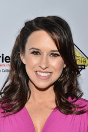 Lacey Chabert looked lovely with her half-pinned feathered waves at the Milk + Bookies Story Time celebration.