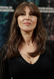 Monica Bellucci wore casual waves with eye-grazing bangs at the photocall for 'On the Milky Road' in Madrid.