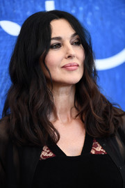 Monica Bellucci wore her hair parted at the center and wavy down the ends during the Venice Film Festival photocall for 'On the Milky Road.'