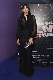 Monica Bellucci polished off her all-black ensemble with a leather clutch.