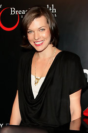 Model and actress Milla Jovovich flaunted her brunette bob while she walked the red carpet in her draped black dress.