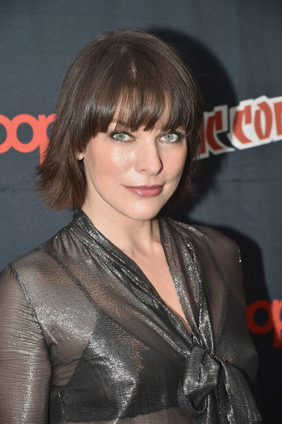 Milla Jovovich Short Cut With Bangs [hair,hairstyle,bangs,layered hair,brown hair,blond,premiere,long hair,black hair,bob cut,new york city,jacob javits center,new york comic con,resident evil photo call,milla jovovich]