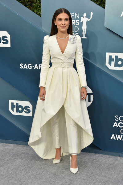 Millie Bobby Brown Wrap Dress [clothing,fashion model,dress,carpet,red carpet,shoulder,hairstyle,fashion,premiere,flooring,carpet,millie bobby brown,screen actors guild awards,screen actors\u00e2 guild awards,red carpet,fashion,celebrity,fashion model,runway,clothing,celebrity,red carpet,supermodel,fashion,model,socialite,haute couture,runway,carpet]