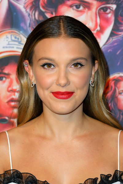 Millie Bobby Brown Red Lipstick [stranger things,season,face,hair,eyebrow,lip,hairstyle,beauty,skin,head,nose,eyelash,millie bobby brown,photocall,photocall,linwood dunn theater,california,hollywood,pickford center for motion study,netflix]