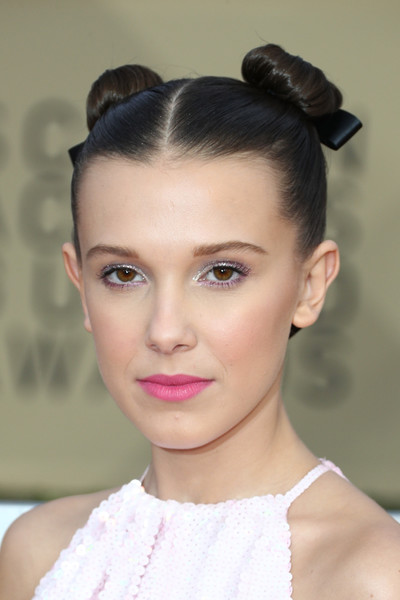 Millie Bobby Brown Pigtail Buns [hair,face,hairstyle,eyebrow,lip,chin,beauty,bun,forehead,fashion,arrivals,millie bobby brown,screen actors guild awards,los angeles,california,the shrine auditorium]