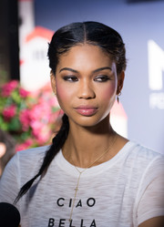 Chanel Iman sported a tight center-parted braid at the Milly for DesigNation collection launch.