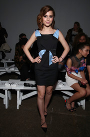 Sami Gayle kept it sweet and youthful at the Milly fashion show in a black mini dress with contrast bow detailing.
