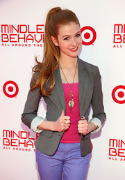 Katherine McNamara dressed up her bright shirt and pants with a classic gray blazer.