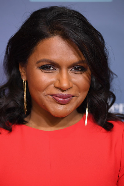 Mindy Kaling Medium Curls [o the oprah magazine hosts special nyc screening of ``a wrinkle in time,a wrinkle in time,hair,hairstyle,eyebrow,lip,chin,black hair,forehead,cheek,long hair,layered hair,mindy kaling,nyc,walter reade theater,screening]