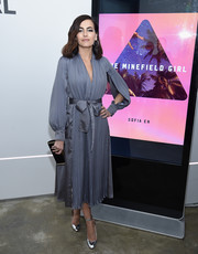 Camilla Belle finished off her chic ensemble with a black and gold box clutch.