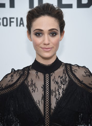 Emmy Rossum brushed her hair back into a loose bun for the 'Minefield Girl' audiovisual book launch.
