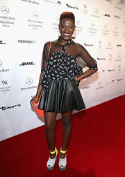 Ivy Quainoo chose a black leather mini skirt to top off her red carpet look at Fashion Week in Berlin.