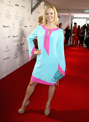 Isabel Edvardsson chose a teal and fuchsia long-sleeve shift dress for her red carpet look at the Minx by Eva Lutz show.