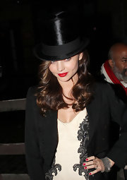 Miranda Kerr looked lovely with luscious red lips at her Halloween party.