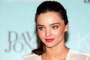 During a promotion for KORA Organics Skincare, Miranda Kerr wore her hair in a casual ponytail.