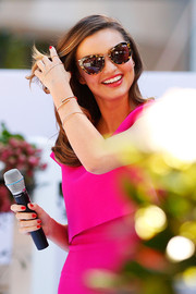 Miranda Kerr attended the Royal Albert teaware event wearing a chic pair of tortoiseshell cateye sunglasses.
