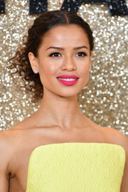 Gugu Mbatha-Raw wore her hair in pinned-up ringlets at the world premiere of 'Misbehaviour.'