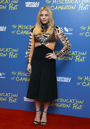Chloe Grace Moretz layered a Proenza Schouler cutout dress over her funky shirt.