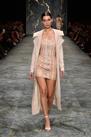 Bella Hadid walked the Misha Collection runway looking sultry in a nude corset dress.