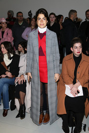 Leandra Medine donned a floor-length glen plaid coat by Rosie Assoulin for the Misha Nonoo fashion show.