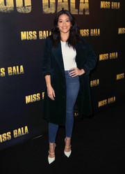 Gina Rodriguez attended the 'Miss Bala' photocall wearing a dark teal velvet coat.
