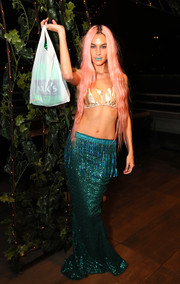 Alexa Chung attended the Misshapes Halloween party dressed as a mermaid in a champagne satin bikini top.