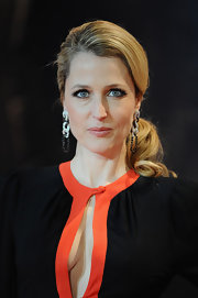 Gillian Anderson wore her hair in a polished ponytail at the UK premiere of 'Mission: Impossible - Ghost Protocol.'