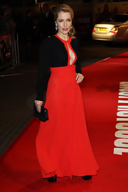Gillian Anderson accessorized her revealing black and red gown with a petite envelope clutch at the UK premiere of 'Mission Impossible Ghost Protocol.'