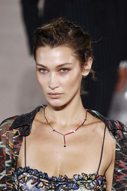 A colorful beaded necklace finished off Bella Hadid's runway outfit.