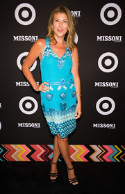 Nina kept her accessories to a minimum by pairing the bright blue frock with simple strappy black sandals.