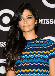 Camila Alves' sultry eyes were enhanced by navy eyeshdow at the Missoni for Target collection launch. To create Camila's smokin' look, line inner and outer rims and top and bottom lash lines with a black liner. Next, apply a dark navy shadow, like Too Faced Intense Shadow in Midnight Mist, to upper lids and blend upward to crease. A soft shade of shadow can be used to highlight inner lids and under the brow bone.
