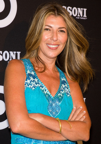 Nina Garcia arrived at the Missoni for Target collection launch with hair flowing. Her look involves blow-drying tresses with a large round brush, parting hair down the center and creating subtle bends away from the face with a large-barreled curing iron.