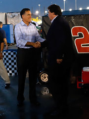 Mitt Romney visited NASCAR in Virginia wearing a pastel blue plaid button-down and black slacks.