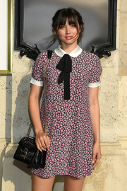 Ana de Armas attended the Miu Miu Cruise 2019 show carrying a stylish black chain-strap bag from the label.