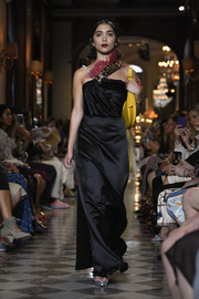 Rowan Blanchard looked vintage-glam in a black satin gown with a beaded and feathered neckline while walking the Miu Miu Cruise 2019 show.