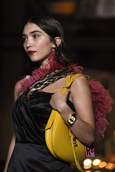 Rowan Blanchard walked the Miu Miu Cruise 2019 runway carrying a cute yellow hobo bag.