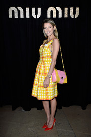 Helena Bordon topped off her colorful ensemble with a pink and yellow matelassé shoulder bag by Miu Miu.